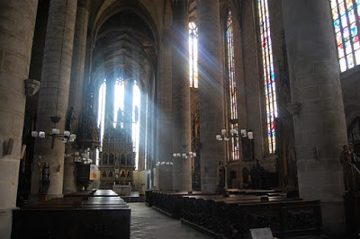 church-inside-light-columns-stained-glass-window